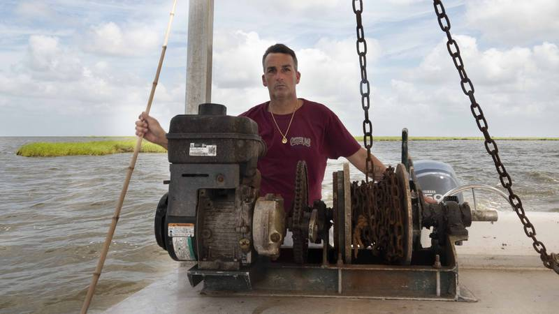 Commercial Fisherman Ryan Guerra operates an oyster dredge over his lease in St. Bernard Parish.