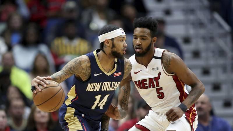 New Orleans Pelicans forward Brandon Ingram (14) dribbles as Miami Heat forward Derrick Jones...