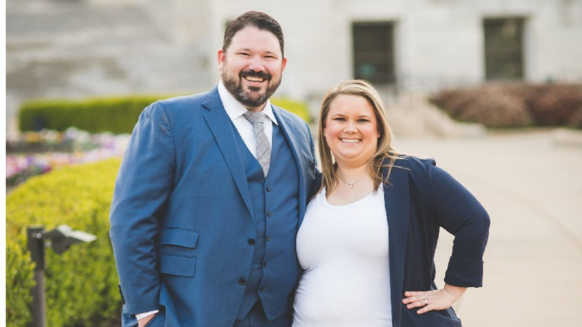 Former Republican Jason Davis, seen here with his wife Emily, announced Monday he will run as a...