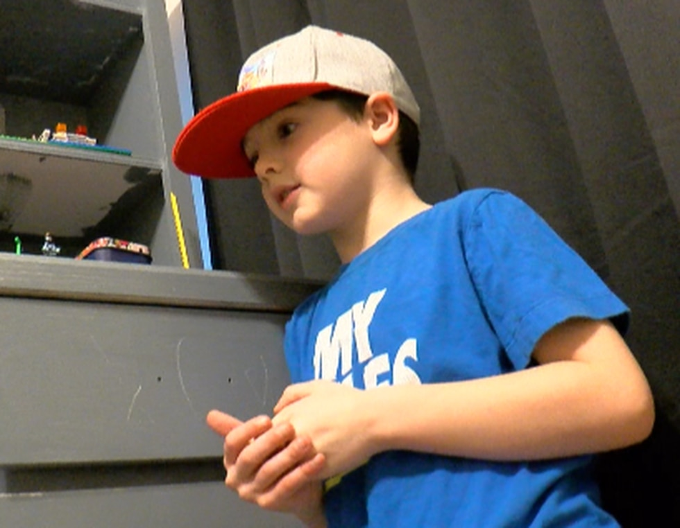 7-year-old Tyler Norris explains why he placed Terry Roberson's name in his prayer box.