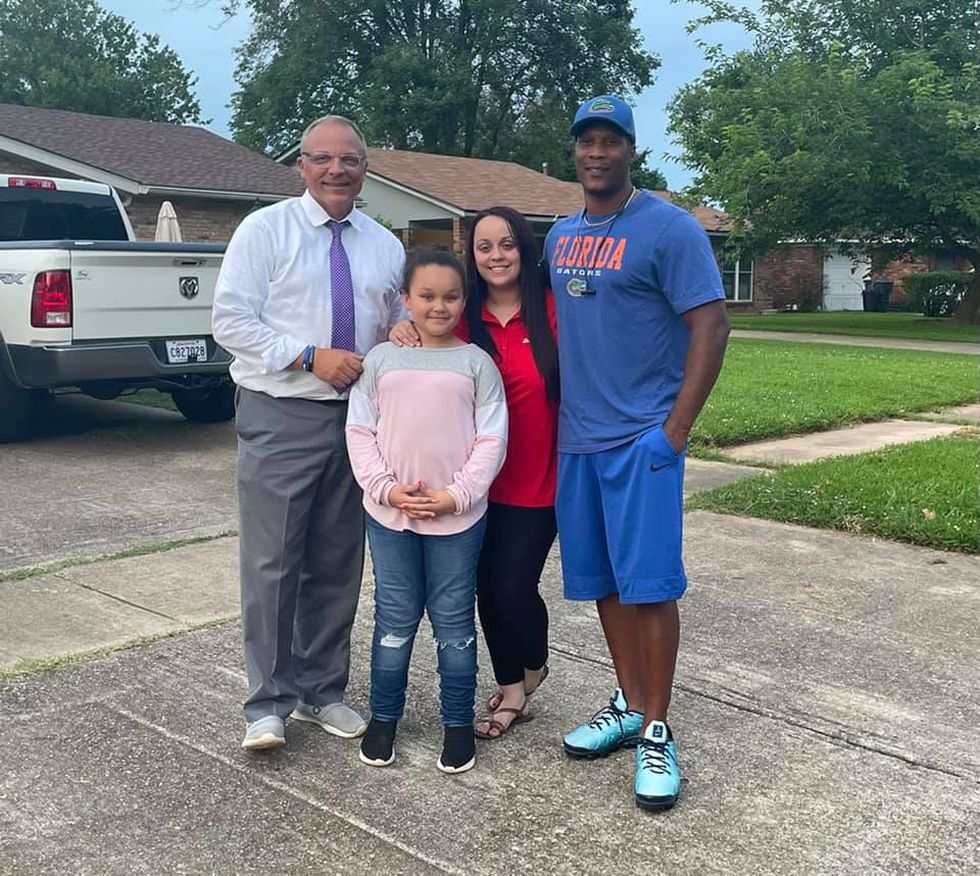 The Leslie family, Rawlis, his wife C.C., and daughter Khloe along with KSLA's Doug Warner