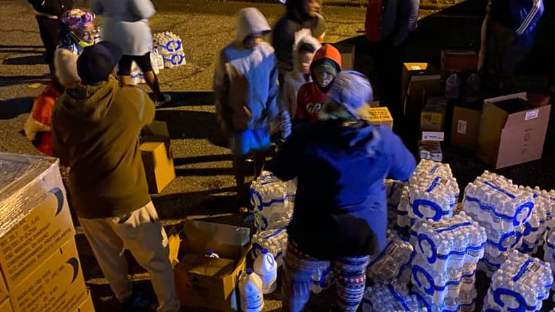 Members of the Shreveport Volunteer Network deliver water and other needed supplies to...