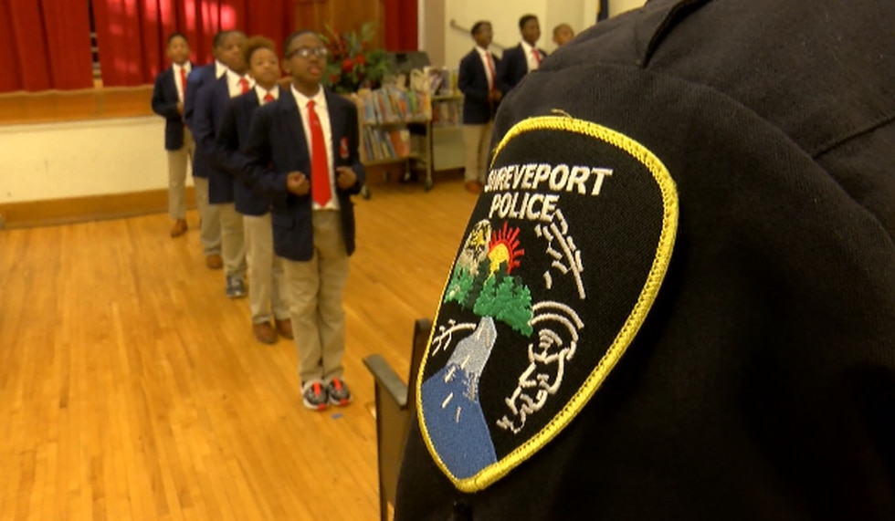 Shreveport police Cpl. Rodney Bradley watches over members of his Young Distinguished Gentlemen...