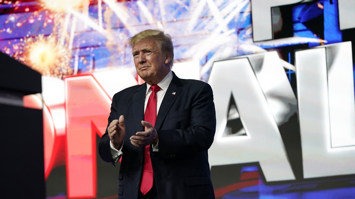 Former President Donald Trump applauds supporters prior to speaking at a Turning Point Action...