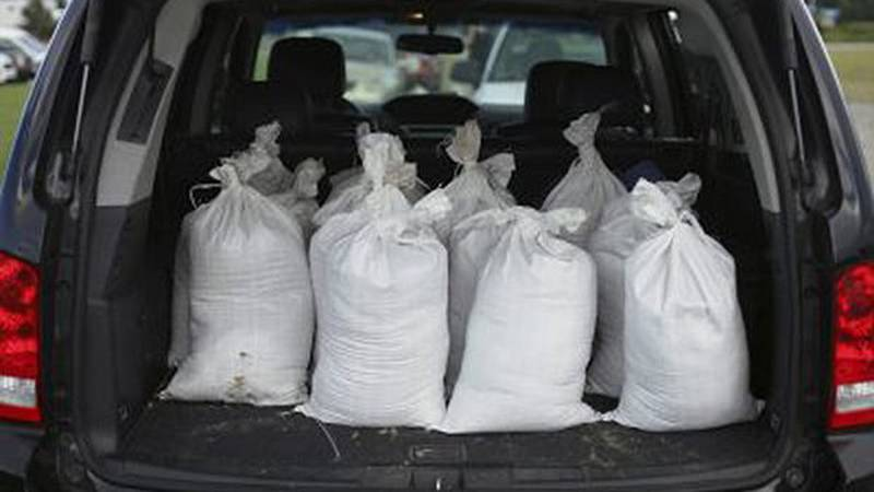 Sand, sandbags, and shovels are available to property owners and local businesses within the...