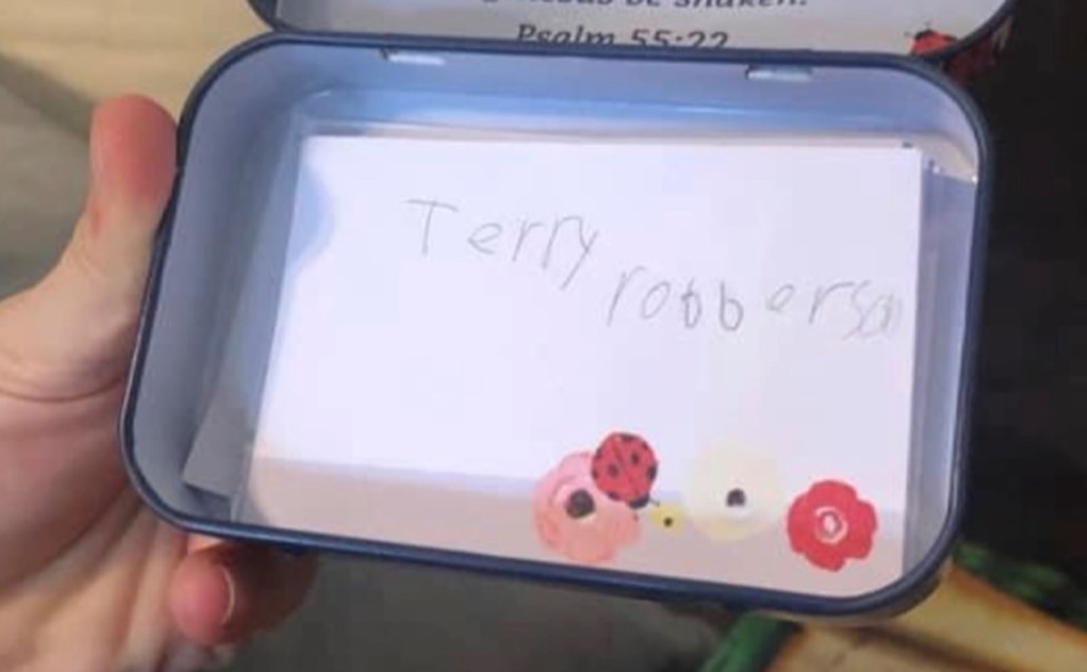 7-year-old Tyler Norris wrote Terry Roberson's name in his prayer box.