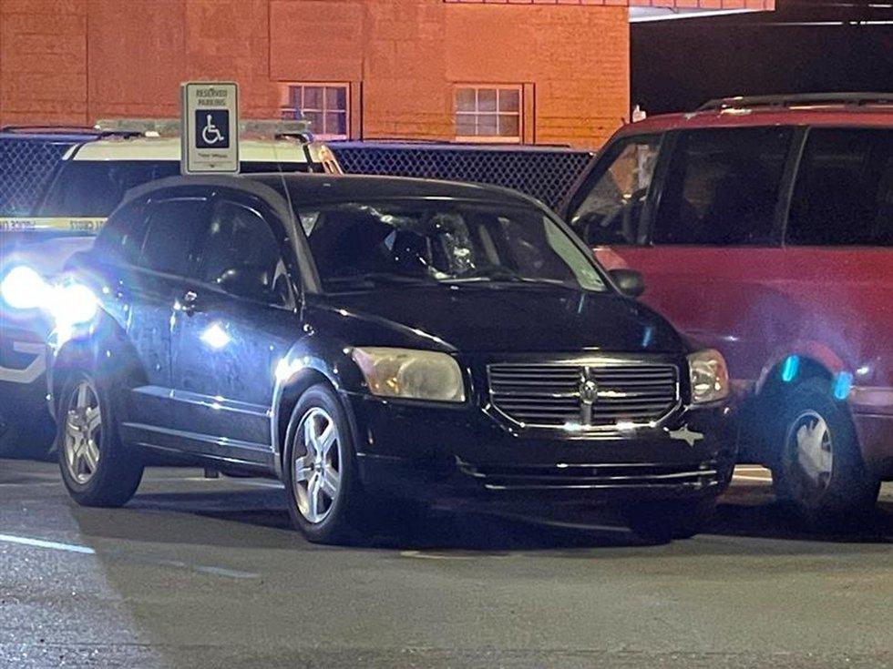 Car with bullet holes in Ochsner parking lot/