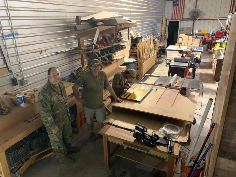 Col. Shayne McGinty and Kelly Watkins inside their workshop in north Bossier Parish.