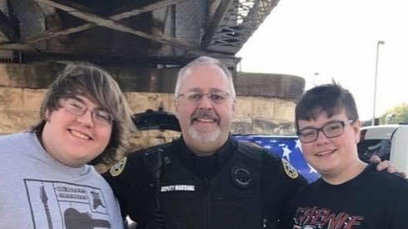 Randy Lambert is flanked by his nephews Landry Wilkinson and Cardis Wilkinson.
