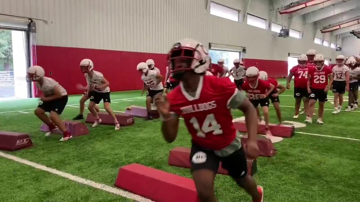 Players with the Carthage High School Football team begin practice.