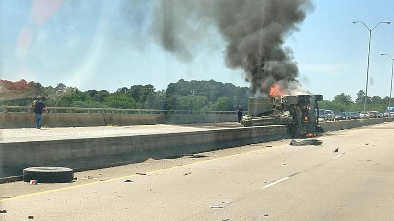 Truck overturns on I-220 and catches fire.