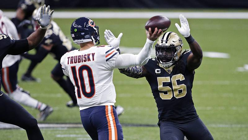 Chicago Bears quarterback Mitchell Trubisky (10) passes under pressure from New Orleans Saints...