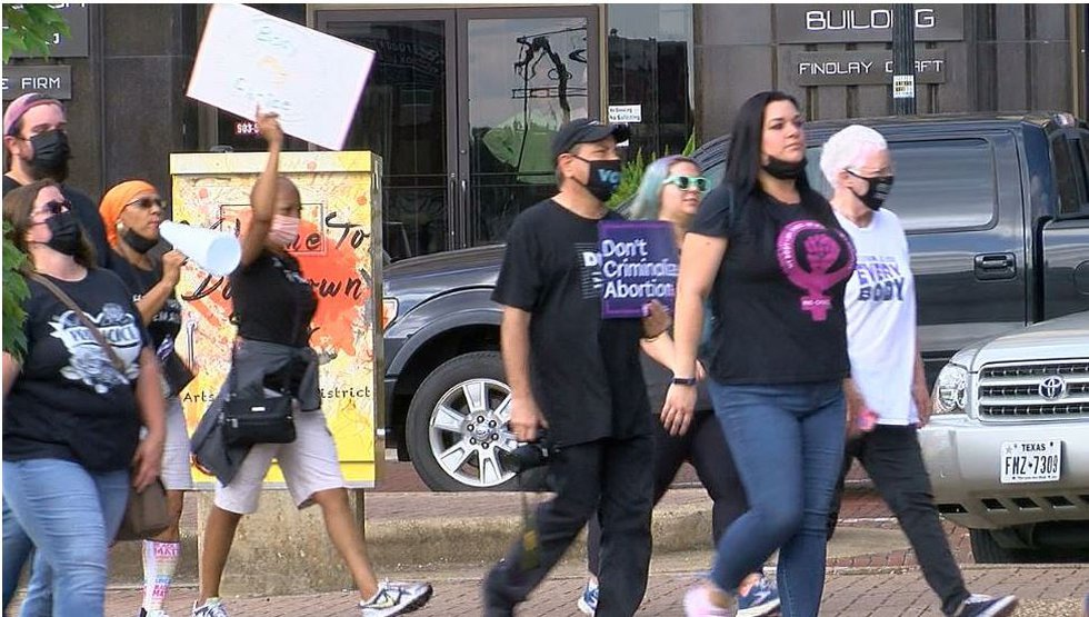Hundreds of people showed up for the East Texas Woman's March on the downtown square in Tyler...