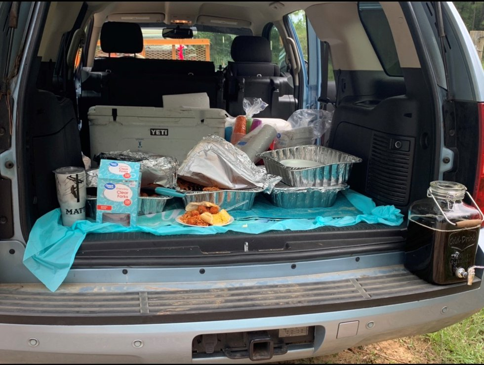 Amy Bush's SUV serves as a buffet table for hard working linemen in the DeQuincy area.