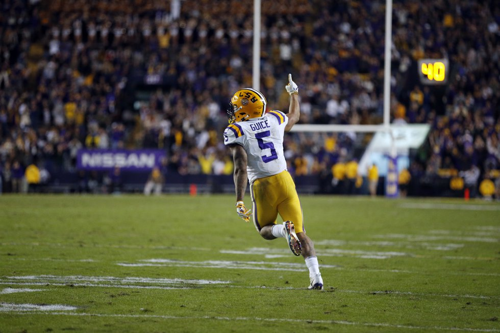 LSU running back Derrius Guice (5) celebrates his touchdown carry in the second half of an NCAA...