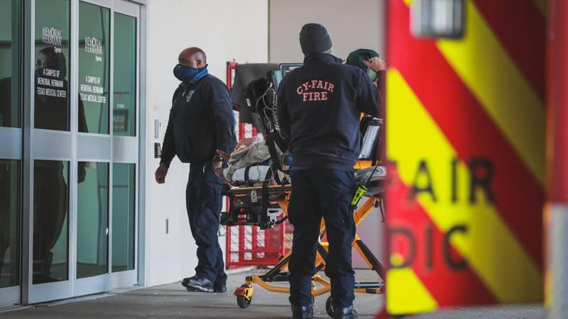 Cy-Fair EMS personnel move a carbon monoxide poisoning victim into a Houston-area hospital....