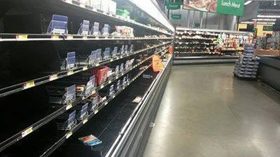 This image, posted on Facebook, shows empty shelves at the Springhill Walmart store after a run...