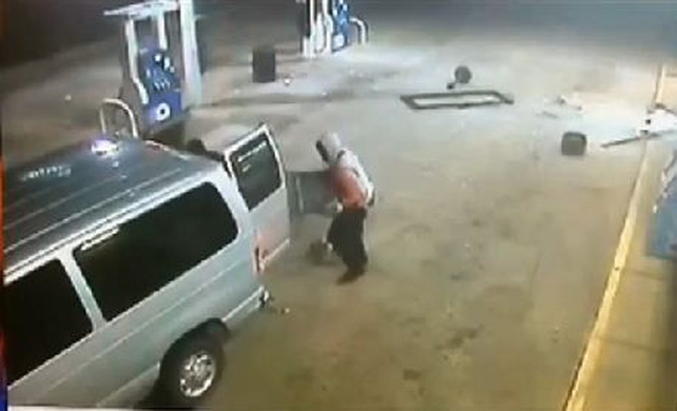 Security camera video captured the theft as the suspects are seen attaching a chain to an ATM...