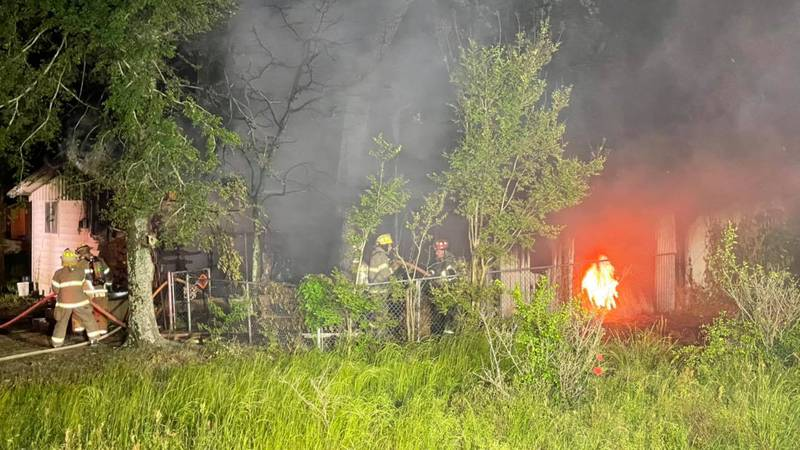 Four Henderson County fire departments battled a house fire in Log Cabin Saturday night....