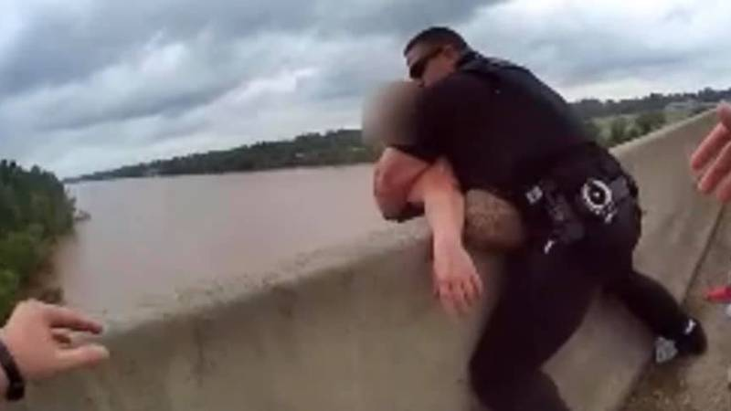Bossier City police officers rush in to rescue a person on the Shreveport-Barksdale Bridge on...