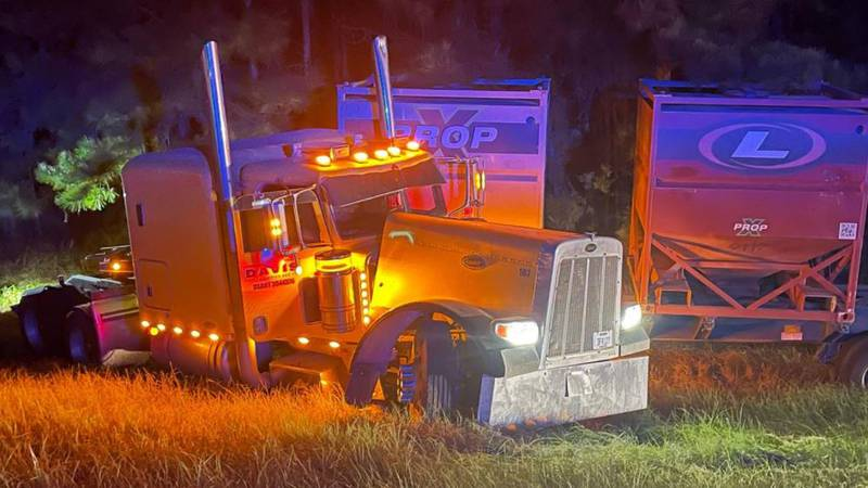 A big rig hauling sand boxes jackknifed on Interstate 49 about a half mile south of Bert Kouns...