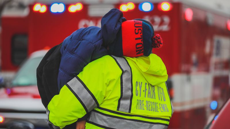 A Cy-Fair volunteer firefighter carries a carbon monoxide poisoning victim to an ambulance....