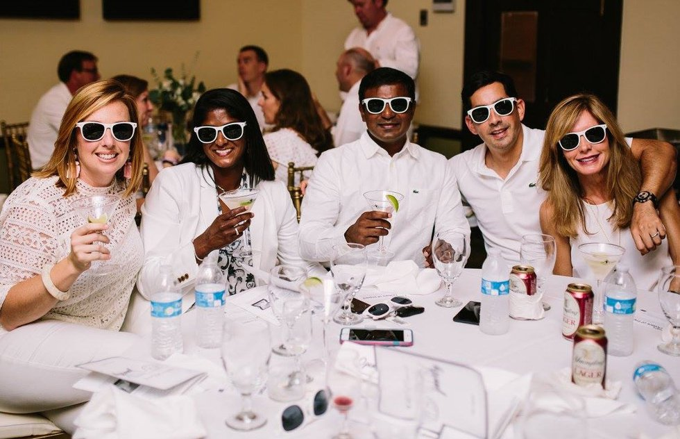 Attendees as a recent 'White Out Cancer Gala' event.