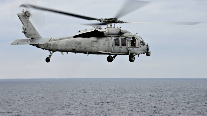 """FILE - An MH-60S Sea Hawk helicopter, assigned to the HSC-25 """"Island Knights,"""" takes off from..."""