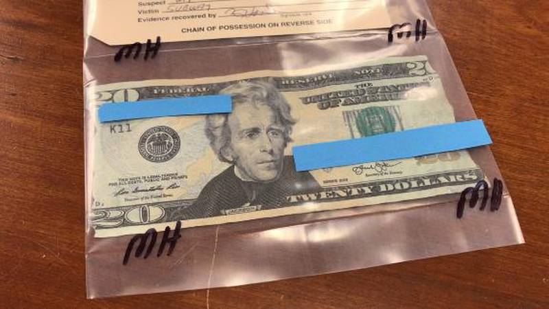 Fake twenty used for a purchase at a restaurant.