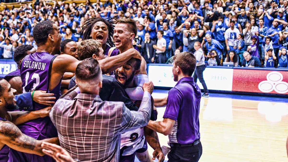 Nathan Bain mobbed by his teammates after hitting a buzzer beater against Duke Tuesday night...