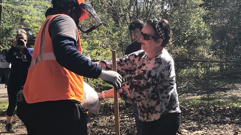 The community came together Friday, March 26, 2021 to cleanup a blighted area on Clanton Street...