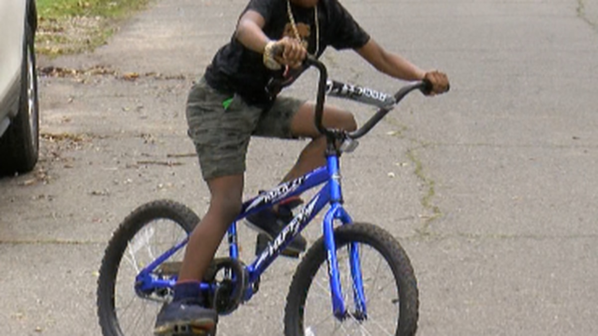 Jordan Levi riding his new bike, given to him by two Shreveport police officers