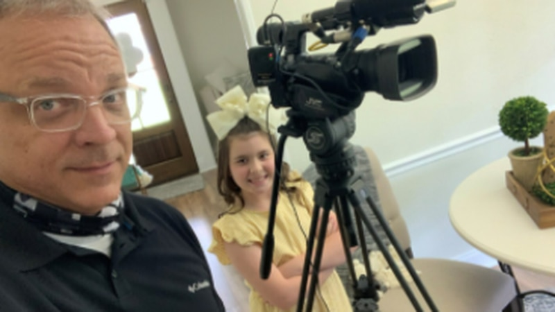 One-time Legacy Elementary student Baleigh Berry posing with KSLA's Doug Warner.