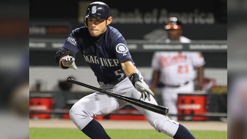 Seattle Mariners right fielder Ichiro Suzuki (51) bunts for a single in the seventh inning...