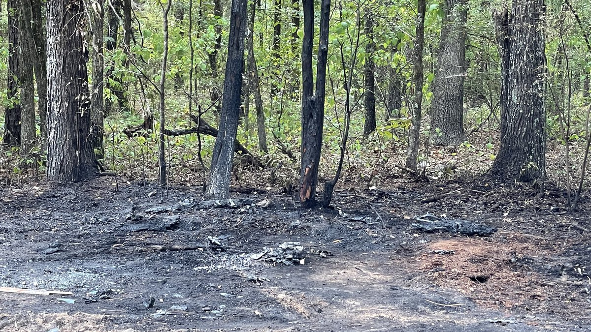 This is the scene where a charred car was found with badly burned human remains inside on...