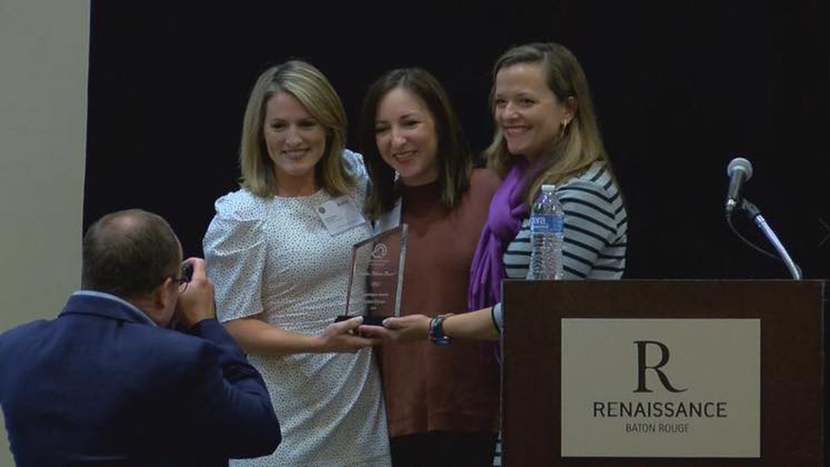 Adria Goins accepts the Golden Pelican Award from the Louisiana Association of Hospitals.