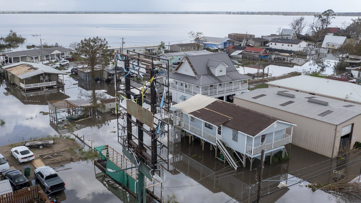 FILE - In this Tuesday, Aug. 31, 2021 file photo, flood waters surround storm damaged homes in...