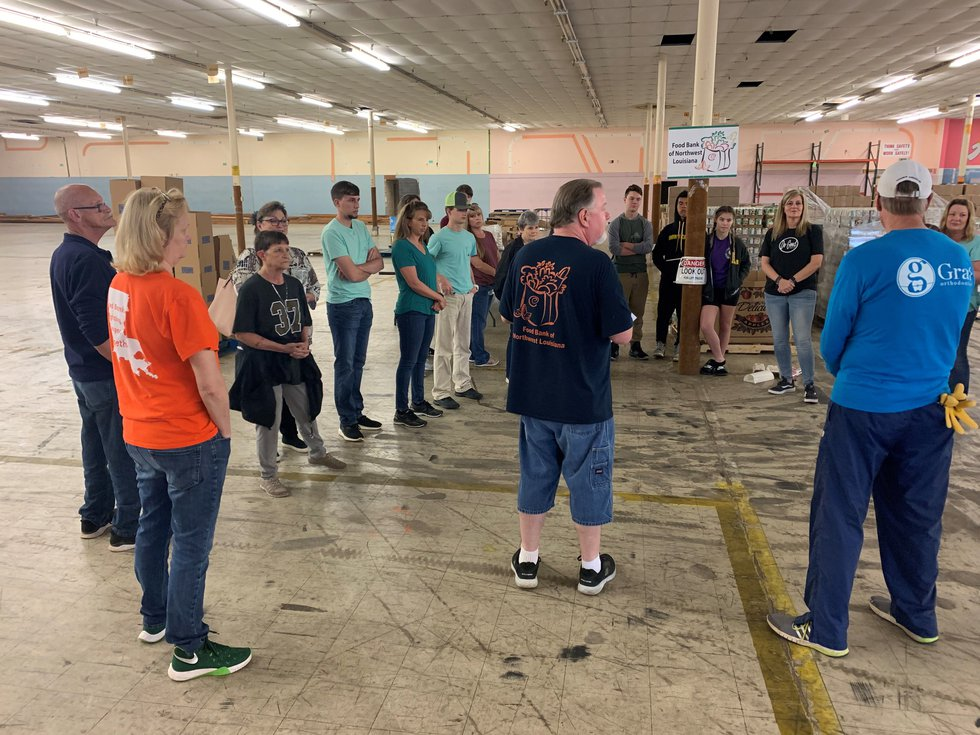 Simple Church volunteers prepare to box food for local families.