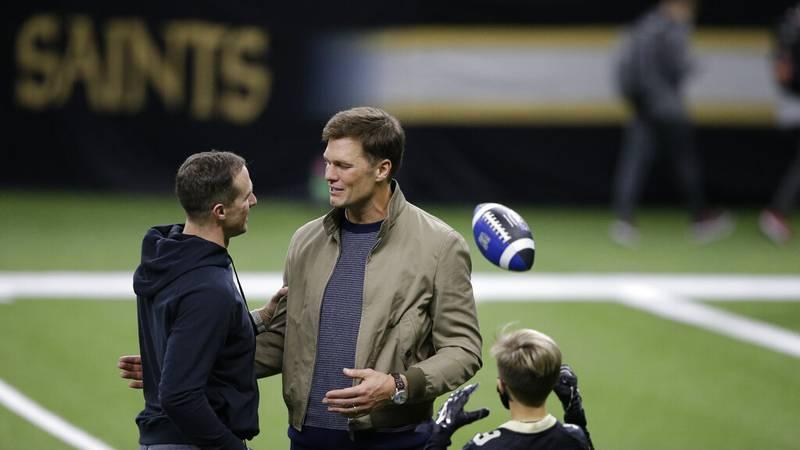New Orleans Saints quarterback Drew Brees, left, speaks with Tampa Bay Buccaneers quarterback...