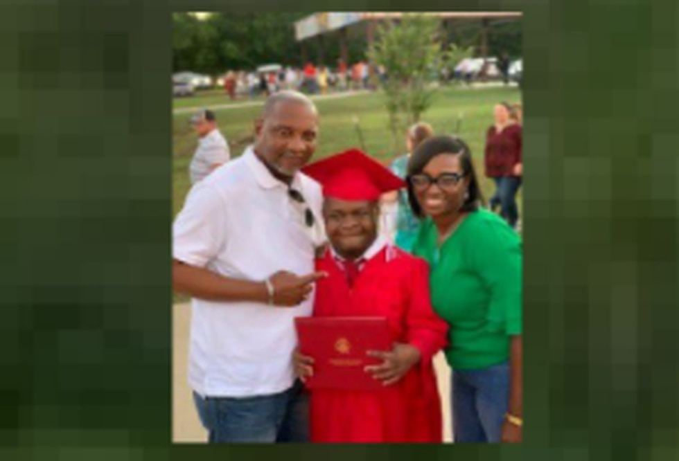 A proud Paul Mashall, Junior posing with his parents on graduation day.