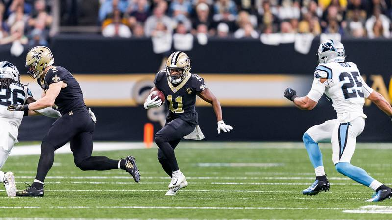 Tommylee Lewis splits a pair of Panthers defenders in a December 2018 game (Source: Mark...