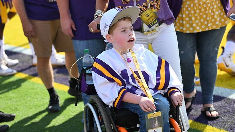 Colton Moore, an Alabama resident, met with Coach Ed Orgeron and watched the Tigers play in...