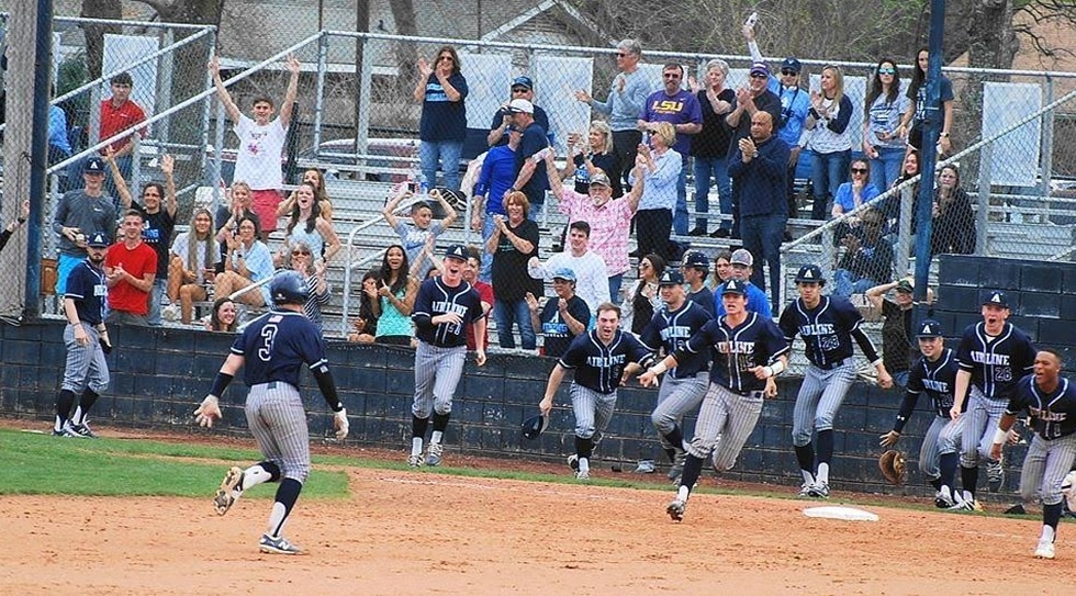 The Airline Viking baseball team celebrates a walk-off win against Ruston in their final...