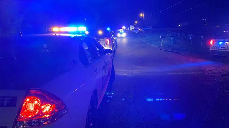 Police respond to scene on NE Front Street.