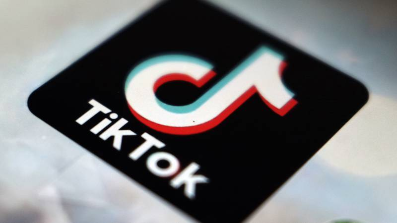 FILE - Several TikTok challenges have school districts across the country on high alert.