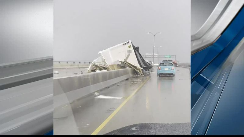 Mobile home flips while being towed on Cross Lake bridge during storm