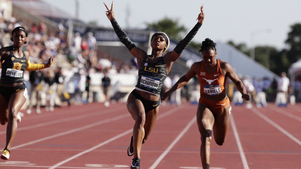 LSU's Sha'Carri Richardson, center, celebrates as she wins the women's 100 meters during the...