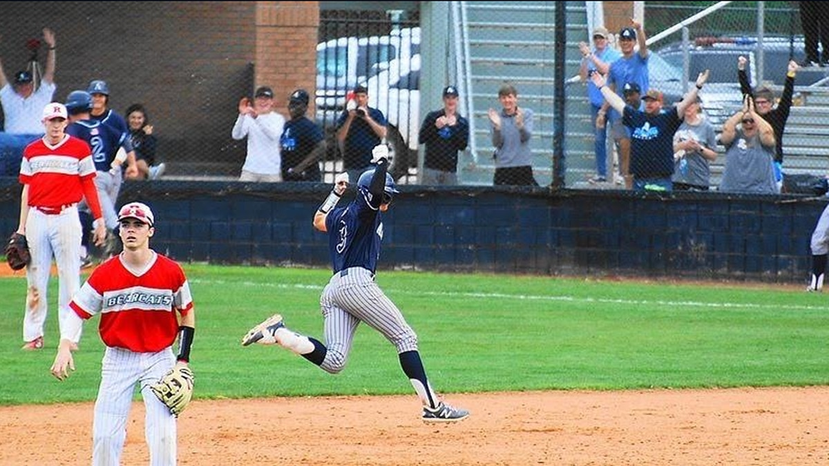 Vikings' senior Bryson Connell celebrates the game-winning hit during after last at-bat of his...