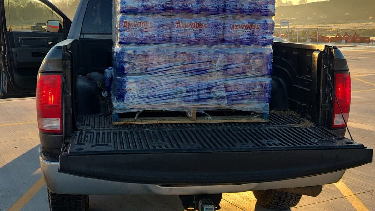 Nolan Williams loads up his truck for a day's worth of bottle water deliveries.