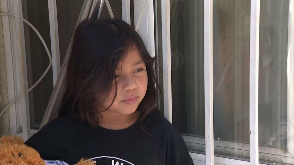 Brianna, 8, clutched her teddy bear after she was the innocent victim of a drive-by shooting....